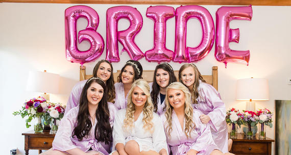 Bridal Party Sitting on Bed